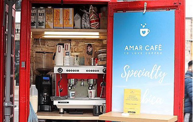 Coffee booth: The Amar cafe (pictured) occupies a red call box in Chiswick, west London