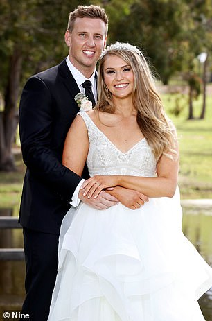 Liam and Georgia are pictured here on their wedding day. Liam is the only openly bisexual groom to feature on Married At First Sight