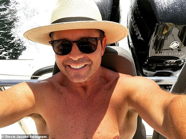 Cheeky: Former Today show weather presenter Steve Jacobswas spotted hamming it up for the paparazzi at Sydney's Bondi Beach last month