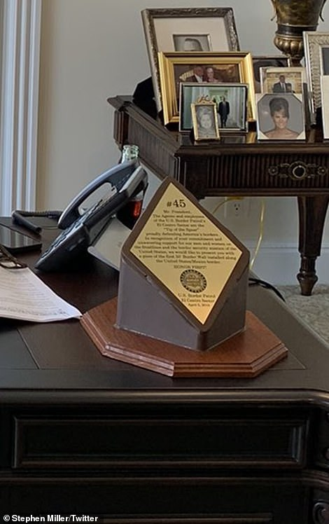 A well-placed bottle was seen hidden behind his phone, just two days after he called for a boycott of Coca Cola for their criticism of Georgia's voting laws. In front of it is an award he received from the Border Patrol in 2019 mounted on a piece of his wall