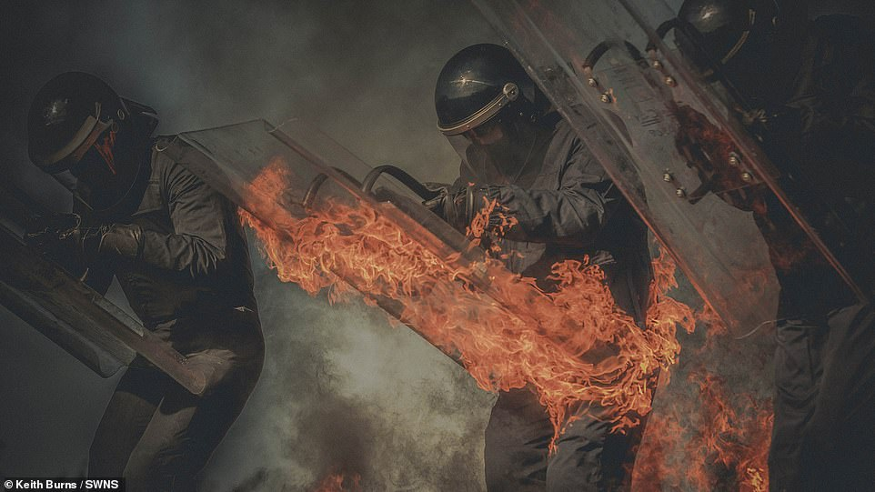 This dramatic shot of prison officers on fire during control training on the Isle of Man won Manx Keith Burns the Documentary picture prize