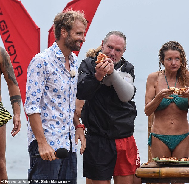 Ravenous! He and the rest of the cast - which features big Italian names such as Gilles Rocca and Massimiliano Rosolino - appeared to win a treat, as they were seen tucking into pizza