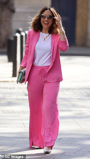 Style: Myleene looked trendy in the oversized blazer and matching baggy trousers and completed the look with white leather high heels