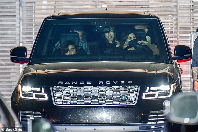 Heading home: Kourtney's son Mason, 11, was in the passenger seat