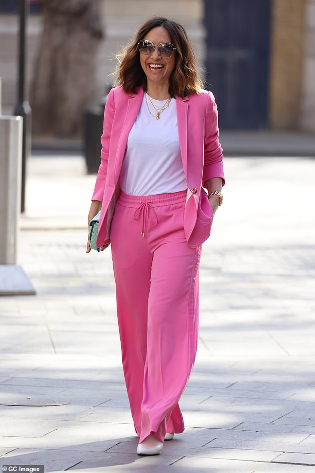 All smiles: Myleene looked in high spirits as she headed to Global Studios in central London
