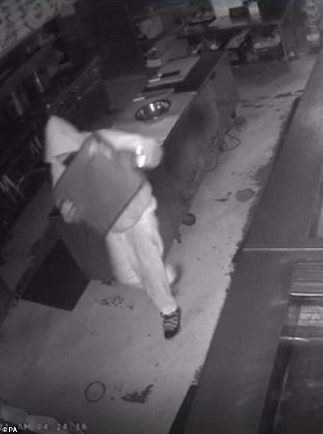 The Facebook post was accompanied by a security footage image of a hooded individual carrying something out of the restaurant and a photo of the venue's smashed glass door