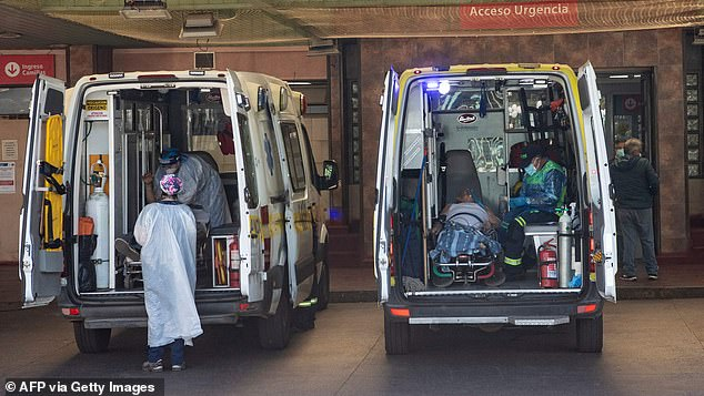 Ambulance personnel wait their turn to be able to admit sick people to the San Jose Hospital following the saturation of the health system due to the high number of Covid-19 infections, in Santiago on April 5, 2021