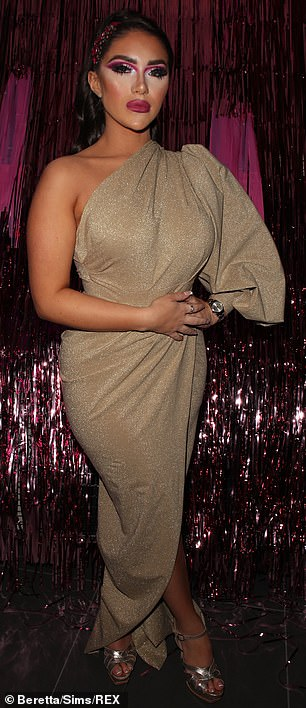 Glitter is gold:Meanwhile Ella's former friend turned foe Chloe Brockett, 20, highlighted her hourglass curves in an asymmetric champagne gown which boasted a puff shoulder and side split