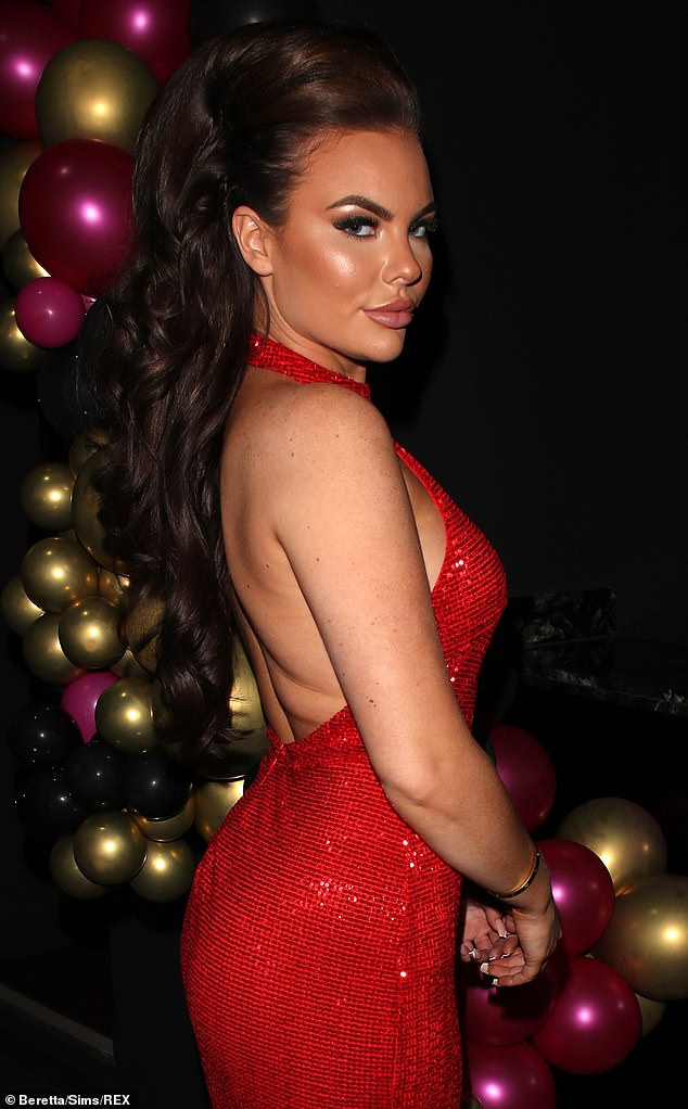 Preened to perfection:She added height to her brunette locks with a wavy bouffant hairstyle while sporting a bronzed make-up look