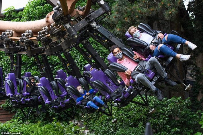 Thrillseekers wear face masks on board the Vampire ride at Chessington World of Adventures which will reopen next Monday