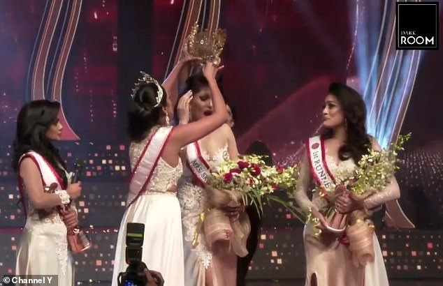 Beauty queen Pushpika De Silva was awarded the title during the ceremony at Nelum Pokuna Mahinda Rajapaksa Theatre, Colombo, on Sunday before the crown was snatched from her head
