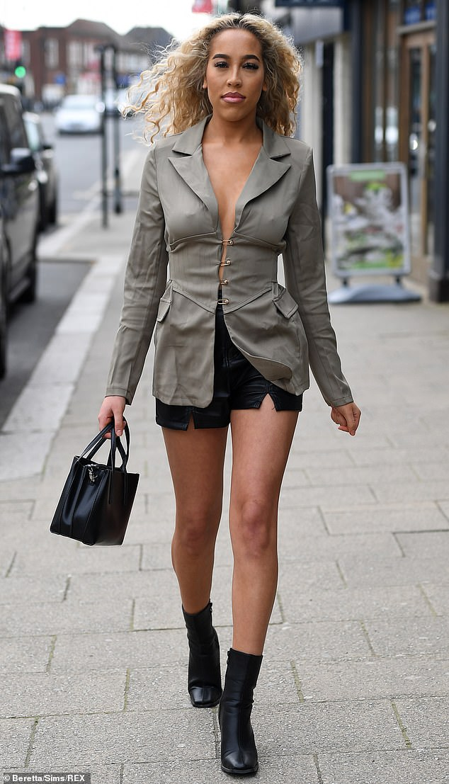 New love? His possible new flame, Dani Imbert made an entrance in a khaki blazer