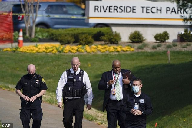 The man entered a business at the Riverside Tech Park (pictured, officers at the scene), causing people inside to flee, but it was unclear if the shooting took place inside or outside, Frederick Police Chief Jason Lando said