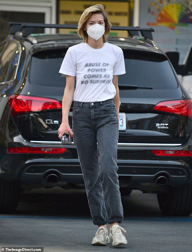 Statement piece:The actress/mother-of-two showed off her hip side wearing a white shirt bearing a phrase from a piece by artist Jenny Holzer