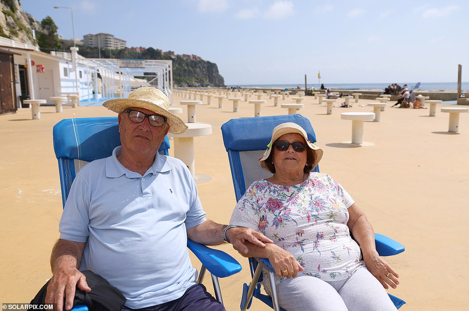 LocalsAdolfo and Antonia Mor enjoy the sun in Gibraltar, where it is legal to be outside without a face covering