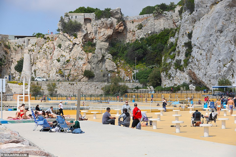 Gibraltar's Minister for Health, Samantha Sacramento, said: 'The measures and precautions we have implemented are working, and we must remember the dedication of our Gibraltar Health Authority staff to achieve this.' Pictured: Locals on the beach