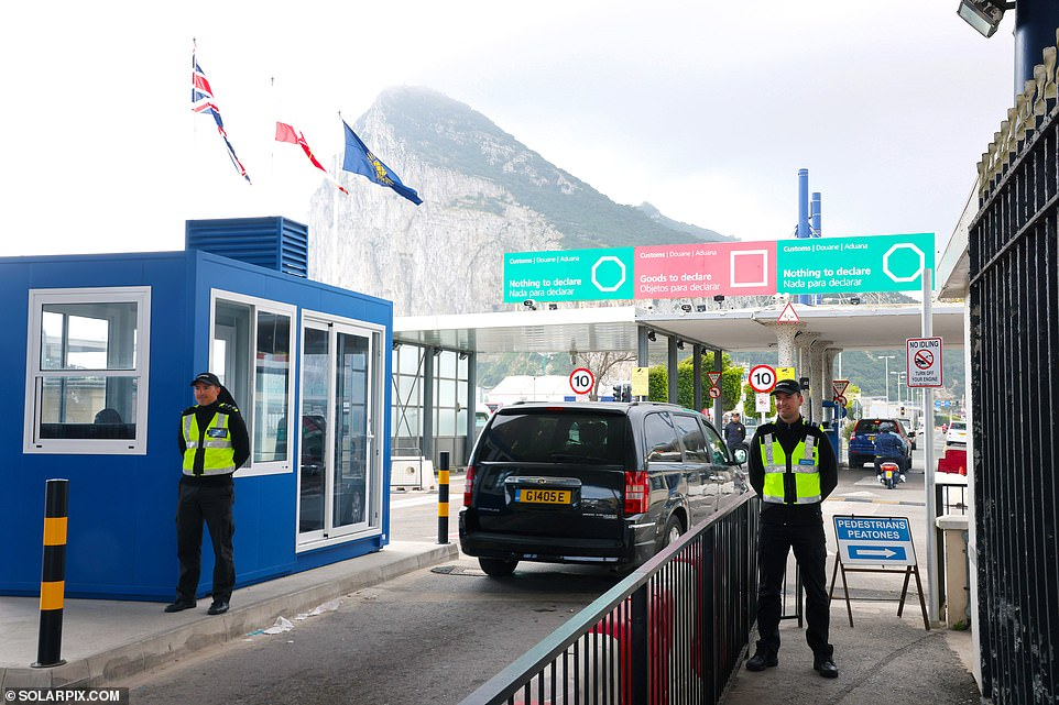 The contrast with Spain is obvious the minute you cross the border (pictured). Visitors leaving the depressed Spanish town of La Linea are waved through passport control by Spanish police in masks less than 100 feet away from their Gib counterparts breathing in fresh air without face coverings
