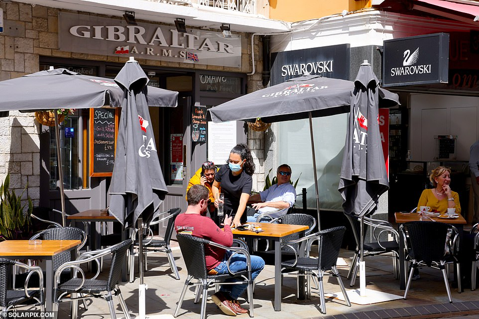 On the Rock, Friday nights in places like Chatham Counterguard and Ocean Village Marina are buzzing with people revelling in the freedom of being able to order alcohol until 1.30am on tables they can share with up to seven friends. Pictured: A bar in Gibraltar
