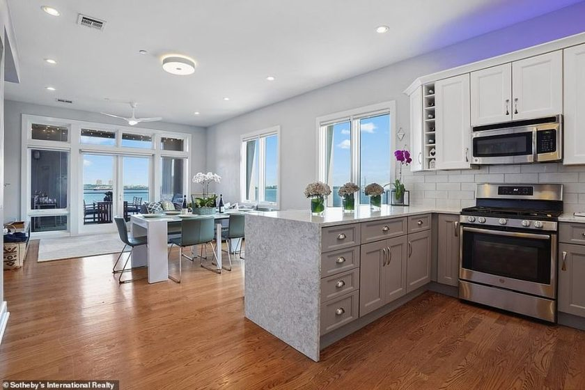 Comforts of home:The kitchen has been completely redesigned to include a peninsula seating area perfect for hosting small gatherings along with quartz countertops and a waterfall installation