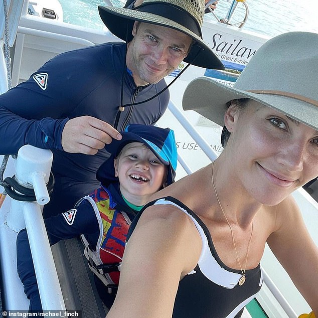 Family outing: The beauty pageant winner-turned-TV host stunned in a monochrome bikini as she posed with her husband, Michael Miziner, and their two children, Violet and Dominic