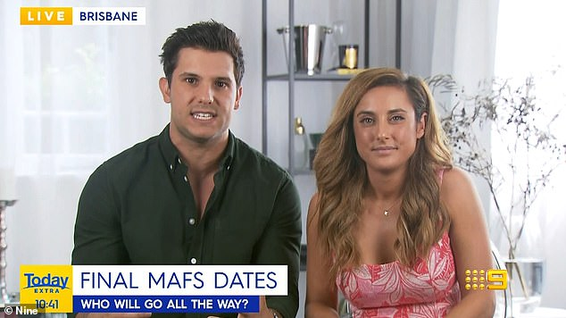 It's a sign!  The couple appeared on Today Extra together on Wednesday and their live interview took place at Johnny's apartment in Queensland.  Although the couple cannot confirm or deny that they are still together, Kerry, 30, said they were 'very happy and delighted' with each other.