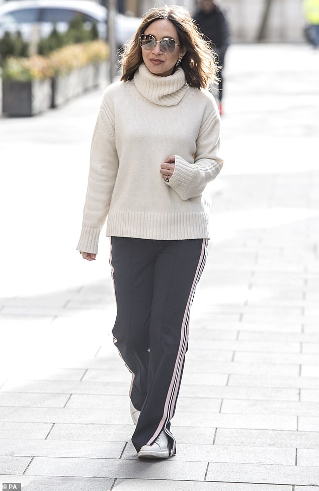 Spring style:Myleene Klass decided to keep it casual on Wednesday as she wore a chic cream turtleneck and tracksuit bottoms for work at Global Radio studios in central London