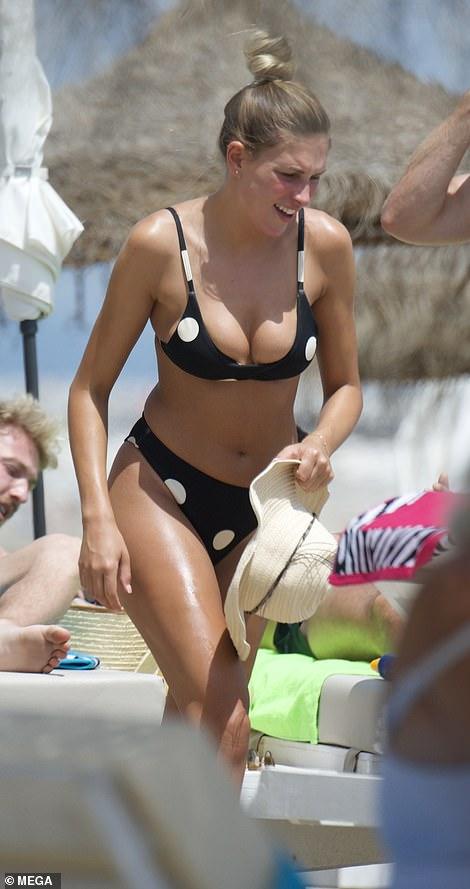 Zara looked stunning on the beach last summer in a monochrome polka dot bikini