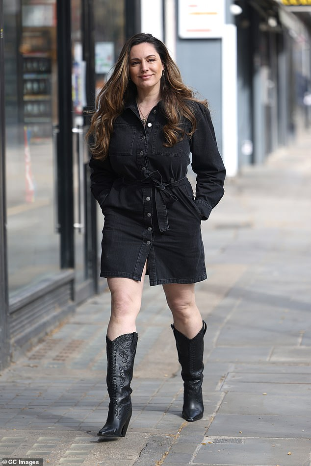 Stunning:Kelly Brook had a spring in her step as she left Global Studios in London on Wednesday after presenting her Heart FM show