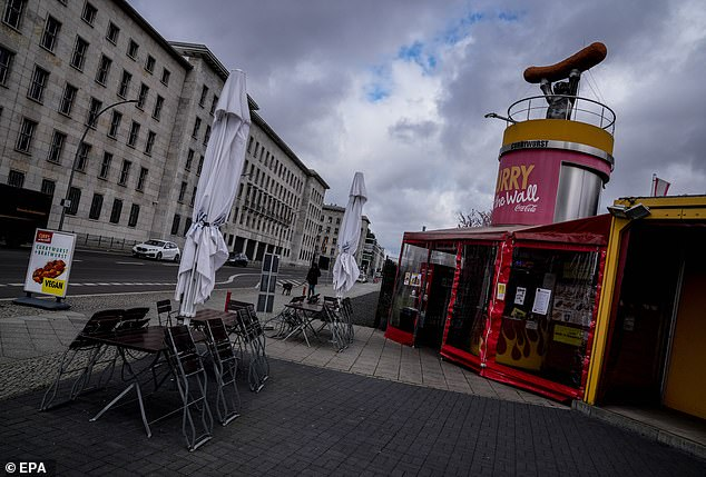 Tables and chairs are empty outside a bratwurst kiosk in Berlin amid the lockdown on Tuesday