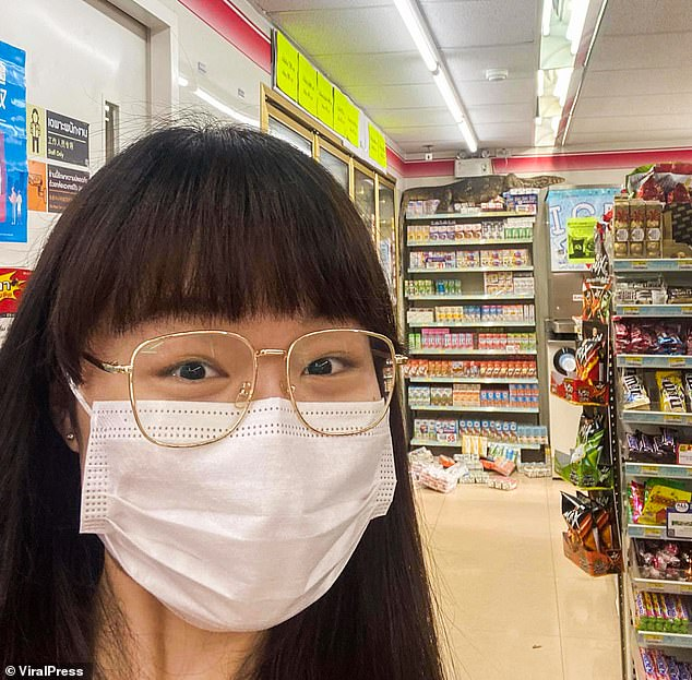 Despite its rampage in the grocery store, the monitor lizard had failed to take food away (customer taking a selfie with the lizard in the store)