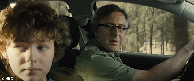 Last moments:In a flashback the little boy - who is called Connor - is seen in a car with his father until they are gunned off the road causing a disastrous car wreck