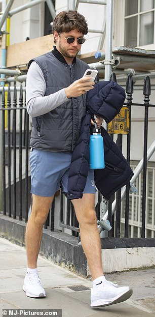 Taking it easy: The former One Direction singer seemed in good spirits on the outing as he strolled past with water bottle in hand