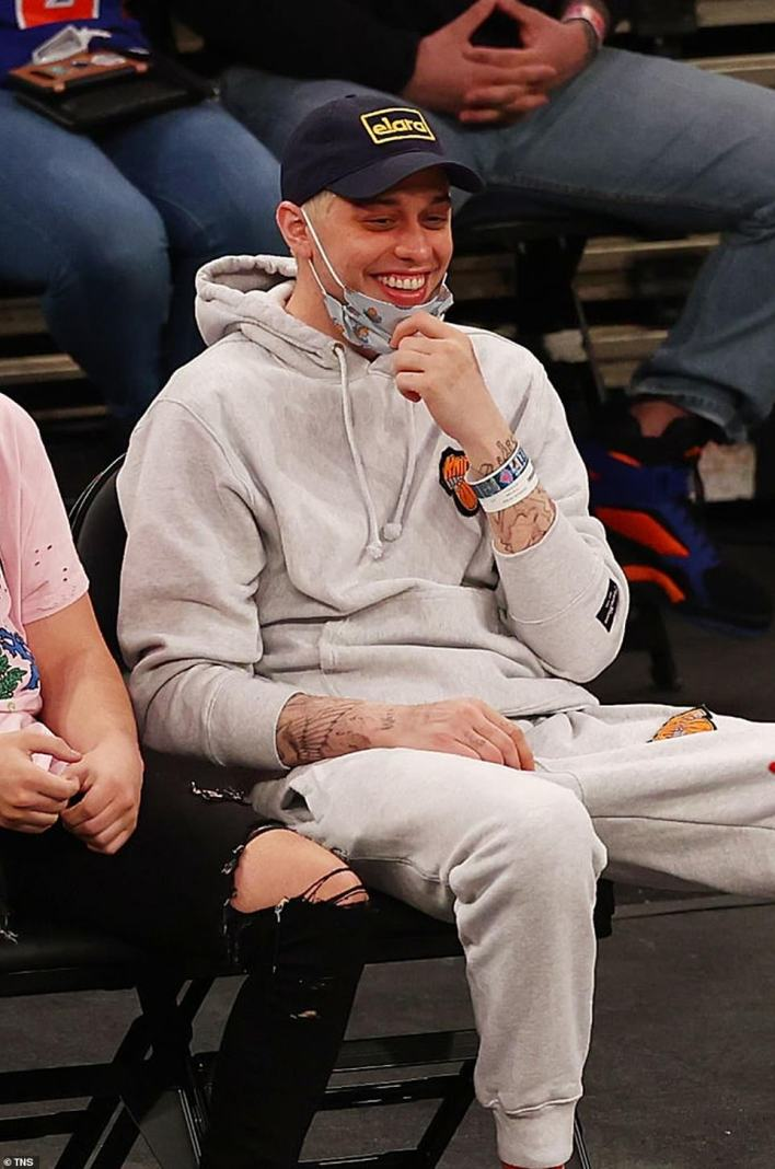 Big changes: The 27-year-old SNL comedian is seen courtside at a New York Knicks game in March 2021. He revealed to fellow SNL star, Colin Jost that he was planning on moving out of his mom's basement in February: 'The thing is my mom is a lot like this show. No matter what I do, I'm never asked to leave. Also, they're both really old and noticeably fatigued'