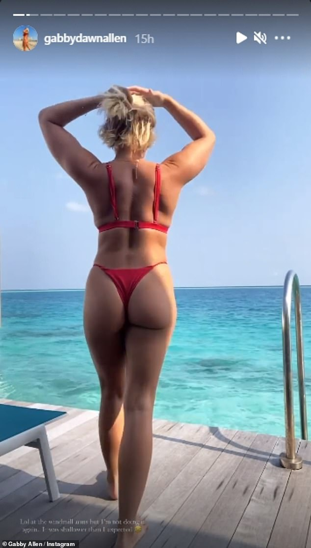 Vacation:She displayed her peachy posterior and toned figure in a red thong bikini as she soaked up the sun