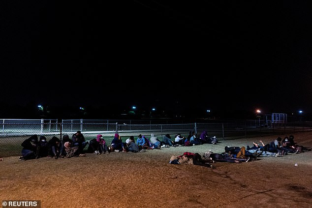 Asylum-seeking migrants' families wait to be transported by the U.S. Border Patrols after crossing the Rio Grande River into the United States from Mexico in La Joya, Texas, on Tuesday