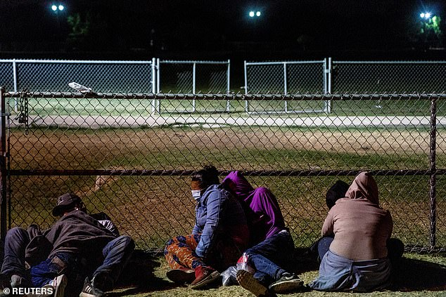 Families seeking asylum from the Biden administration rest at a park in La Joya, Texas, on Tuesday