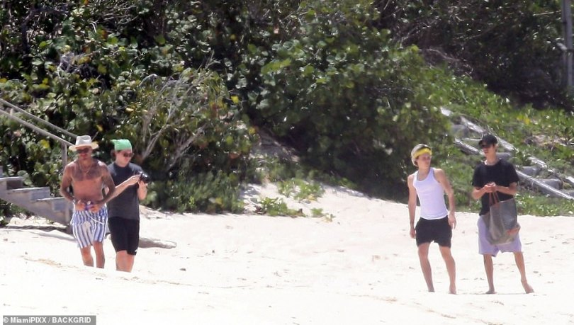 The Beckham boys: Brooklyn, 22, Romeo, 18, and Cruz, 16, joined their dad at the beach