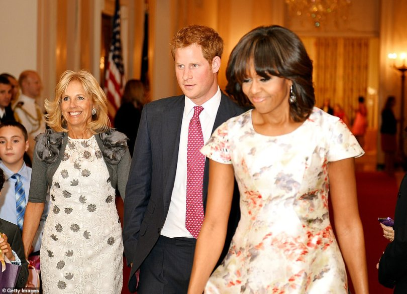 Jill Biden, Prince Harry, and Michelle Obama meet with military families at the White House during Prince Harry's May 2013 visit to the United States