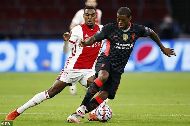 Liverpool are reportedly keen on Ryan Gravenberch (left) to replace Gini Wijnaldum (right)