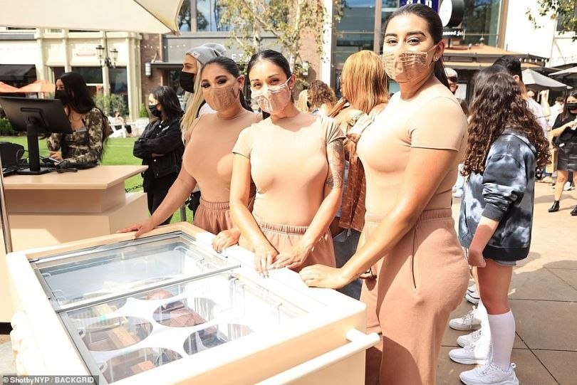 Ready for you!The SKIMS pop-up shop featured attendants rocking the brand's latest pieces in a nude tone that coordinated with the shop's exterior