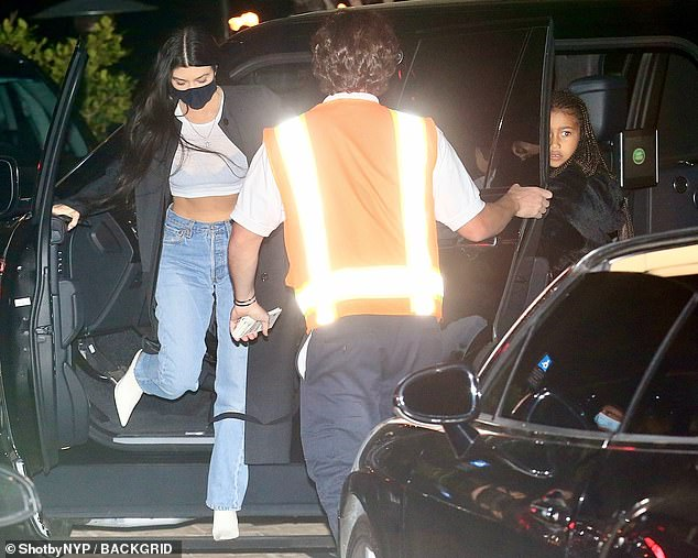 A valet with reflective stripes on their waistcoat helped the famous celebrity park her car