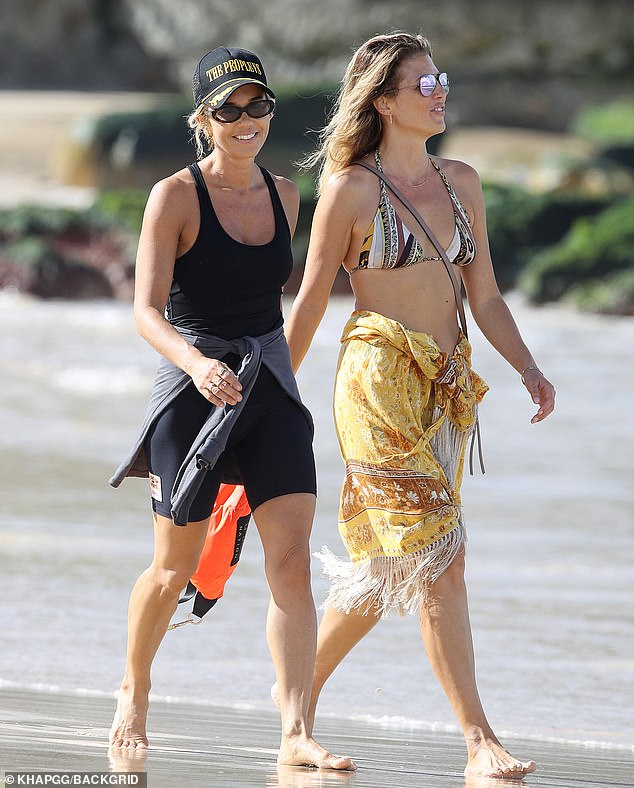 What to smile about?  Pip Edwards beamed as she enjoyed a walk with a friend at Bondi Beach on Thursday - amid rumors she reunited with ex-boyfriend Michael Clarke