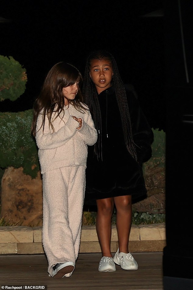Family night out: Kourtney brought daughter Penelope, eight, and niece North West, seven, daughter of Kim Kardashian and Kanye West