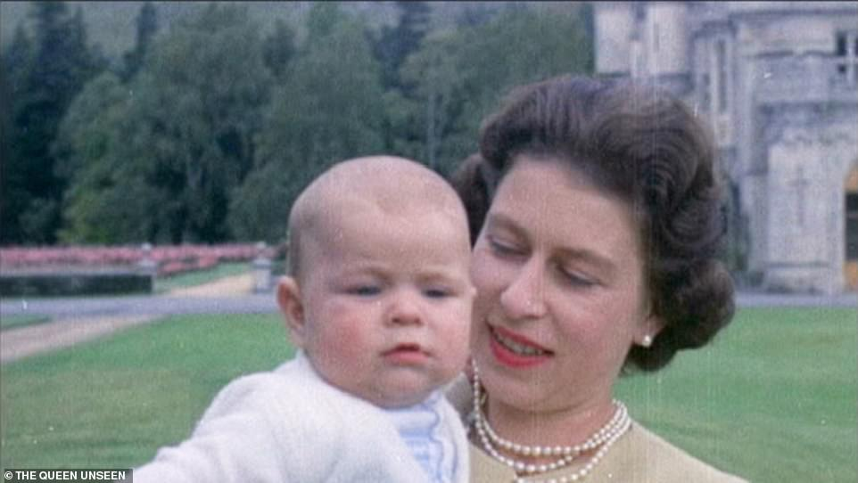 The Queen with Prince Andrew as a baby at Balmoral in 1960. Andrew is pictured aged seven months old in one of the first pictures in colour taken of the young prince. With the arrival of her third child, the Queen spent more time with her family