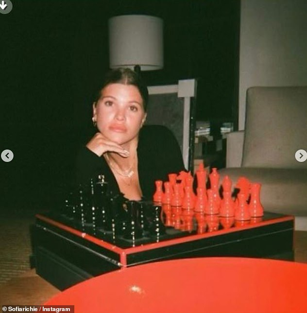 Stunning: Showing off her modeling skills, Richie also posed for a stoic portrait in front of a stylish red and black chess set