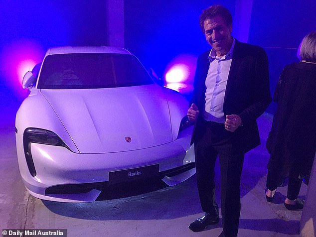 Multimillionaire Andrew Banks, the founder of recruitment agency Morgan and Banks who has featured on Ten's Shark Tank,took delivery of his white Taycan in February at a Porsche dealership in south Sydney. The launch dinner featured Finder co-founder Fred Schebesta and public relations queen Roxy Jacenko