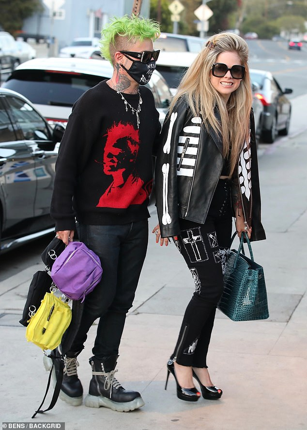 Sweet: The Flames hitmaker looked in love with Avril as he held her hand while they were outside the restaurant