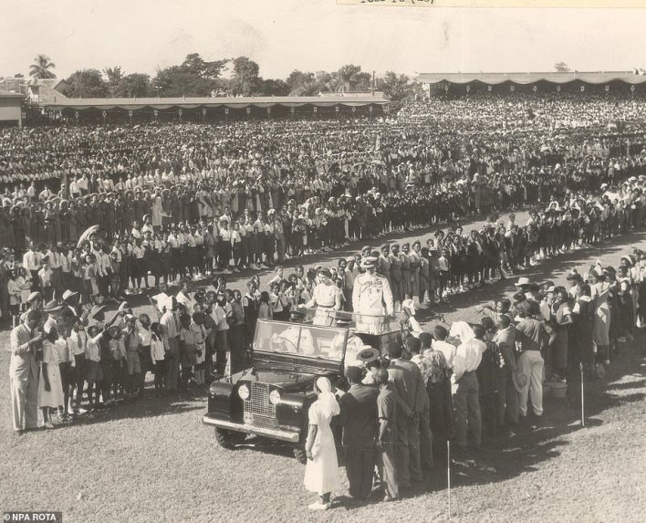 The Queen and the Duke of Edinburgh drive into Kingston's Sabina Park in Jamaica standing in a Land Rover in November 1953