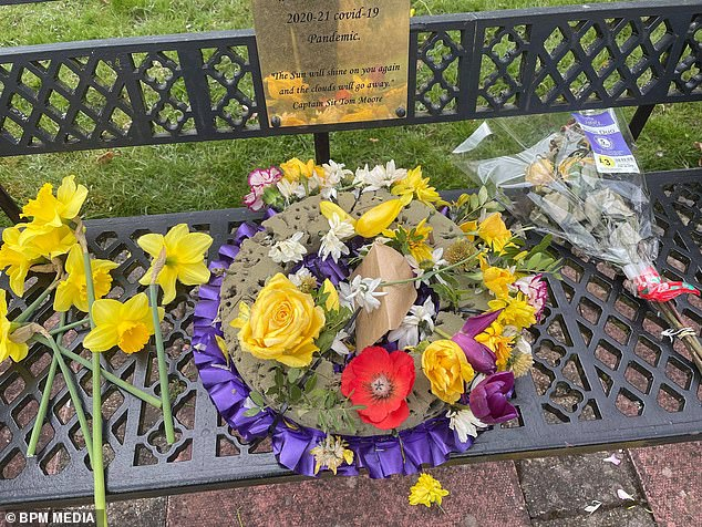 Pictured: The flower wreath that had been placed at the memorial in Stoke-on-Trent to pay tribute to the 703 residents who died from coronavirus, before the flowers were ripped out by vandals