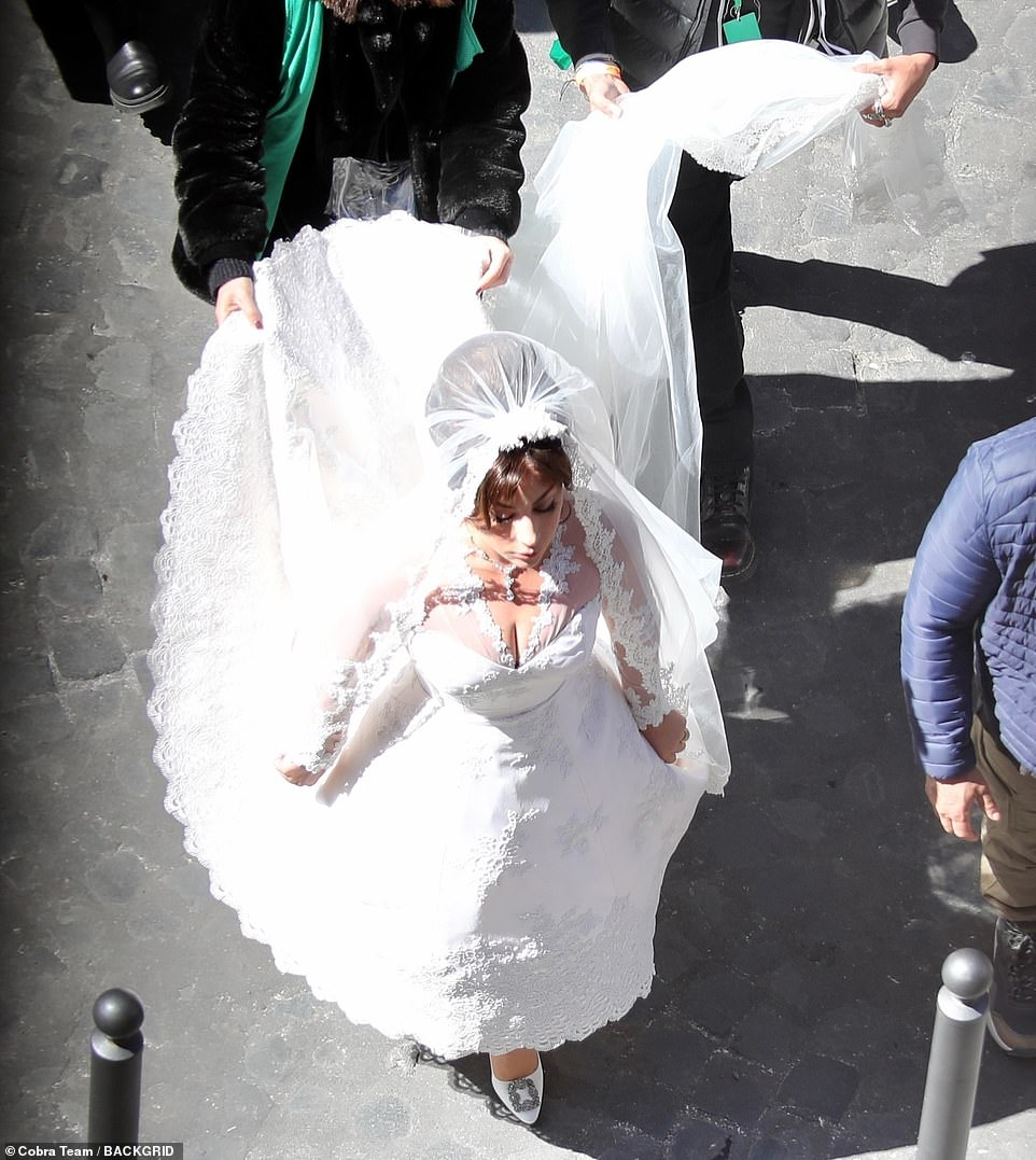 Wow: Gaga wowed in the stunning white bridal gown during the busy day of filming in Rome, Italy